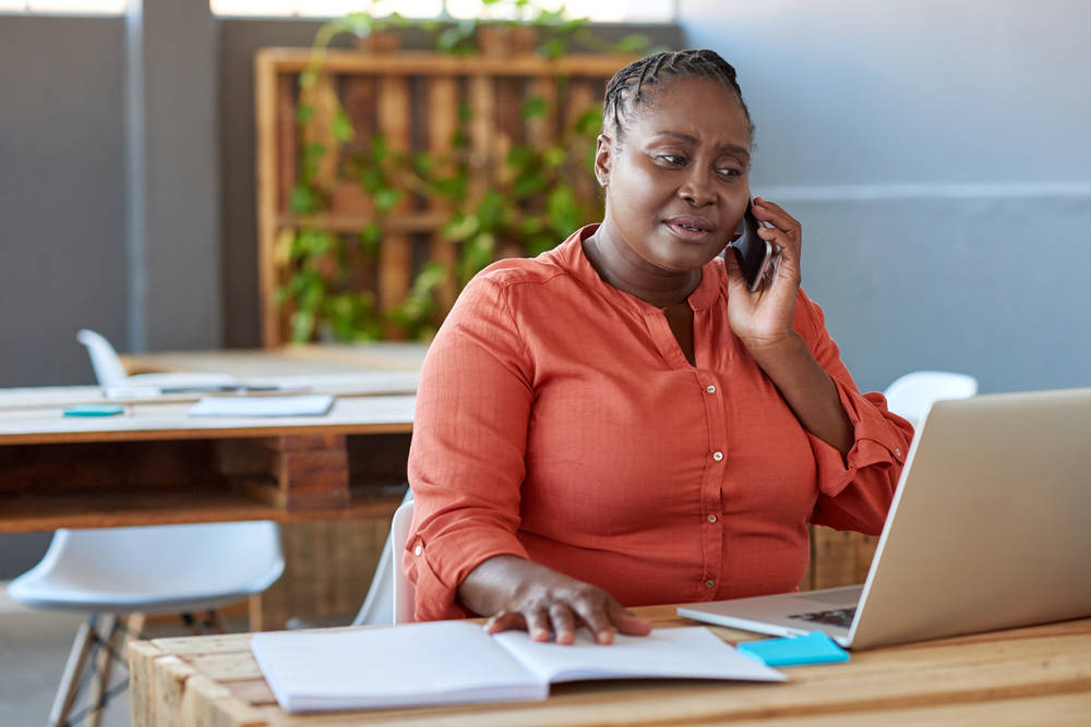 Woman using a variety of tools to increase her productivity as an entrepreneur