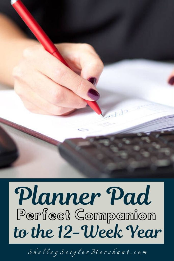 Woman writing in Planner Pad