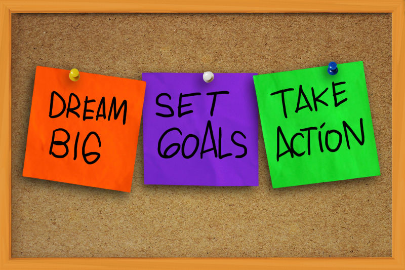 bulletin board with sticky notes to dream big, set goals, and take action